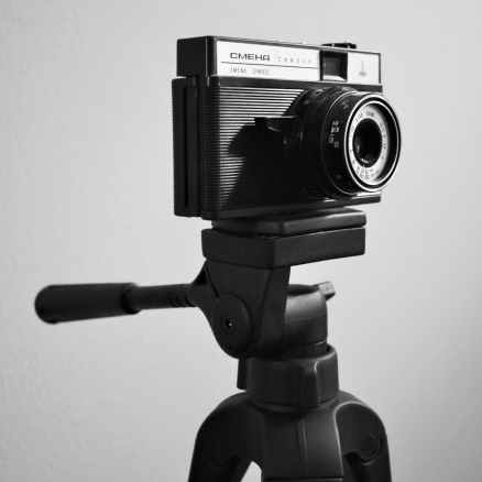 greyscale photo of camera on tripod