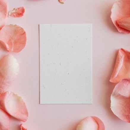 empty card among pink rose petals