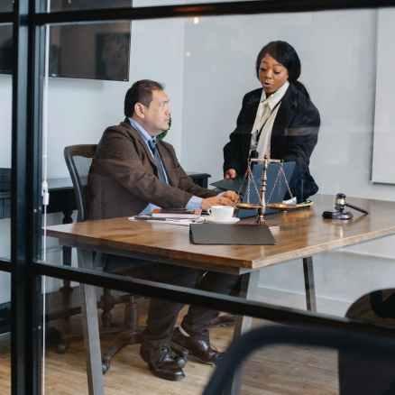 female secretary talking with boss in lawyer office