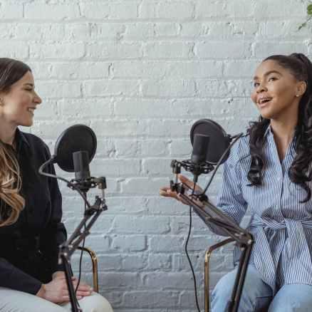 positive black woman talking to radio host